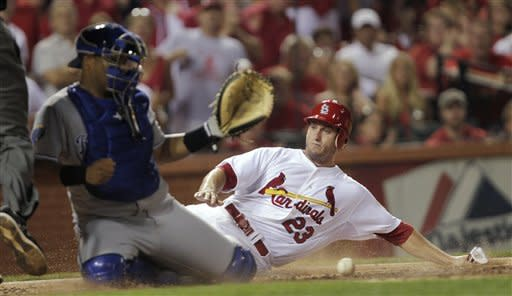 Moustakas' throw saves Royals' 3-2 win over Cards