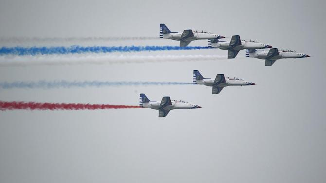 Taiwan's air force flies AT-3 jets trailing colored smoke during a parade marking the 70th anniversary of the end of WWII, at the military base in Hsinchu, northern Taiwan, Saturday, July 4, 2015. Taiwan marched out thousands of troops and displayed its most modern military hardware Saturday to spotlight an old but often forgotten claim that its forces, not the Chinese Communists, led the campaign that routed imperial Japan from China 70 years ago. (AP Photo/Wally Santana)