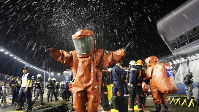 Civil Defence members take part in an evacuation drill ahead of the Singapore F1 Grand Prix at the Marina Bay street circuit in Singapore