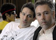 "FILE - In this July 26, 2006 file photo, Beastie Boys members Adam Yauch ""MCA,"" right, Adam Horovitz ""Adrock,"" center, and Mike Diamond ""Mike D,"" reflected in a mirror, pose for a photograph during an interview in Toronto. Yauch, the gravelly voiced Beastie Boys rapper who co-founded the seminal hip-hop group, has died at age 47. The cause of death wasn't immediately known. Yauch, who's also known as MCA, was diagnosed with a cancerous parotid gland in 2009. (AP Photo/The Canadian Press, Aaron Harris)"