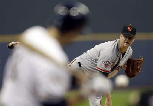 Gallardo homers, pitches Brewers past Giants