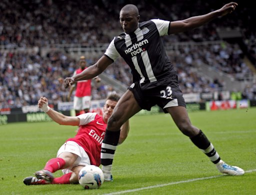 Newcastle United's English striker Shola Ameobi vies with Arsenal's French defender Laurent Koscielny (L) during the English Premier League football match between Newcastle United and Arsenal at St James' Park in Newcastle, north-east England on August 13, 2011. AFP PHOTO/IAIN BUIST