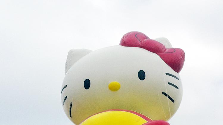 "FILE - In this Nov. 10, 2012 file photo provided by Macy's, the ""Hello Kitty"" balloon floats over the Meadowland's race track during a test flight in East Rutherford, N.J. ""Hello Kitty"" is one of three new balloons to be featured in the 2012 Macy's Thanksgiving Parade. (AP Photo/Macy's, Inc.)"