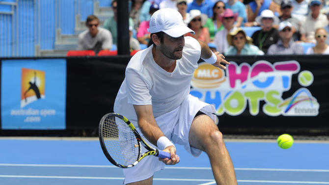 Brian Baker of the US hits a forehand return to compatriot Sam Querrey during their second round match at the Australian Open tennis championship in Melbourne, Australia, Wednesday, Jan. 16, 2013. (AP Photo/Andrew Brownbill)