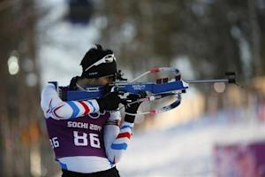 """Fourcade of France takes part in a biathlon training session for the 2014 Sochi Winter Olympic Games at the """"Laura"""" cross-country and biathlon centre in Rosa Khutor"""