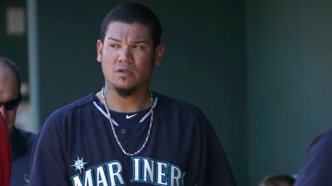 Seattle Mariners' Felix Hernandez paces the dugout after being pulled from the game during the second inning of a spring training baseball game against the Cleveland Indians Tuesday, March 31, 2015, in Goodyear, Ariz. (AP Photo/Ross D. Franklin)
