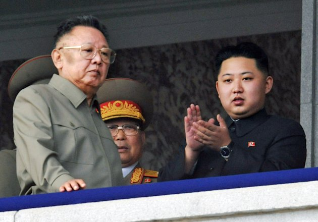 FILE - In this Oct. 10, 2010 file photo Kim Jong Un, right, along with his father and North Korea leader Kim Jong Il, left, attends during a massive military parade marking the 65th anniversary of the