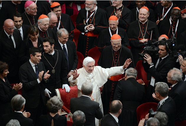 Pope Benedict XVI salutes attendees at the end of a concert at La Scala theater in Milan, Italy, Friday, June 1, 2012. Pope Benedict XVI greeted the faithful in the square outside Milan's cathedral af