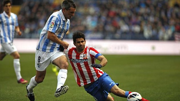 Jeremy Toulalan of Malaga and Atletico Madrid's Diego Costa (Reuters)