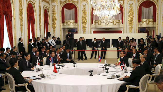 Japan's PM Shinzo Abe delivers an opening speech as other leaders of Mekong delta nations listen during the Mekong-Japan Summit Meeting in Tokyo
