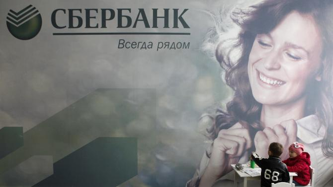 Children draw inside an office of Sberbank in the southern city of Stavropol