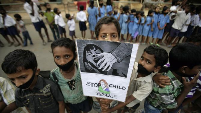 Indian children participate in a protest against child abuse and rising crimes against women, in Bhubaneswar, India, Saturday, March 16, 2013. India has seen outrage and widespread protests against rape and attacks on women and minors since a fatal gang-rape of a young woman in December on a moving bus in New Delhi, the capital. In the most recent case, a Swiss woman who was on a cycling trip in central India with her husband has been gang-raped by eight men, police said. (AP Photo/Biswaranjan Rout)