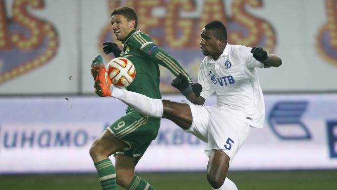 Dinamo Moscow's Douglas fights for the ball with Panathinaikos' Marcus Berg during their Europa League soccer match at the Arena Khimki stadium outside Moscow