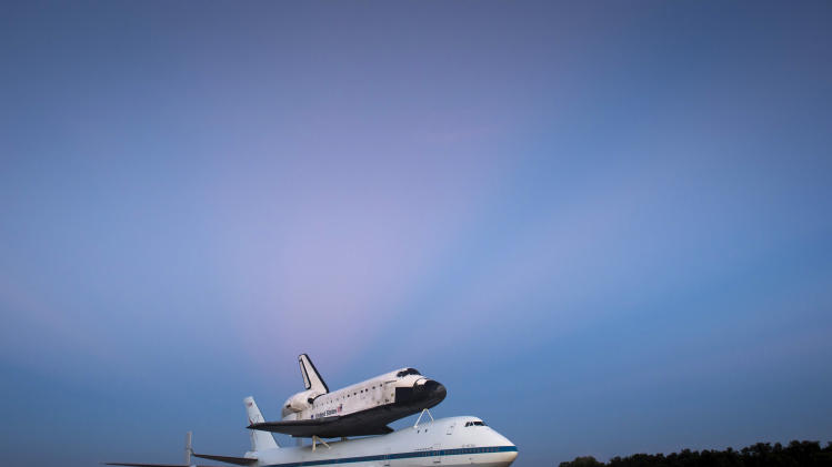 This photo provided by NASA shows space shuttle Endeavour atop NASA's Shuttle Carrier Aircraft, or SCA, at the Shuttle Landing Facility in the early morning hours at NASA's Kennedy Space Center on Tuesday, Sept. 18, 2012 in Cape Canaveral, Fla. The SCA, a modified 747 jetliner, will fly Endeavour to Los Angeles where it will be placed on public display at the California Science Center. This is the final ferry flight scheduled in the Space Shuttle Program era. (AP Photo/NASA, Bill Ingalls)