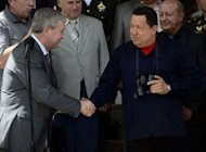 Venezuelan president Hugo Chavez shakes hands with Belarusian Deputy Prime Minister Vladimir Semashko (L) at Miraflores presidential palace in Caracas