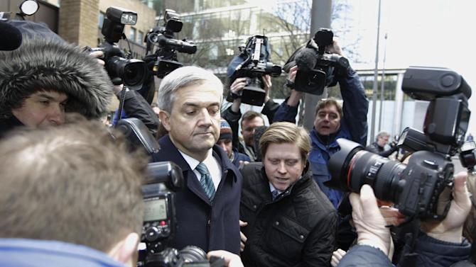 Former government Energy Secretary Chris Huhne faces the media outside Southwark Crown Court in London Monday Feb. 4, 2013, after he pleaded guilty to the charge of obstruction of justice for persuading his then wife Vicky Pryce to say she had been driving the car, so he could avoid a driving ban.  Member of Parliament Huhne resigned from the cabinet after the Crown Prosecution Service announced that he and Pryce would face charges, and told reporters outside court on Monday that he would be resigning from his parliamentary seat. (AP Photo/Sang Tan)