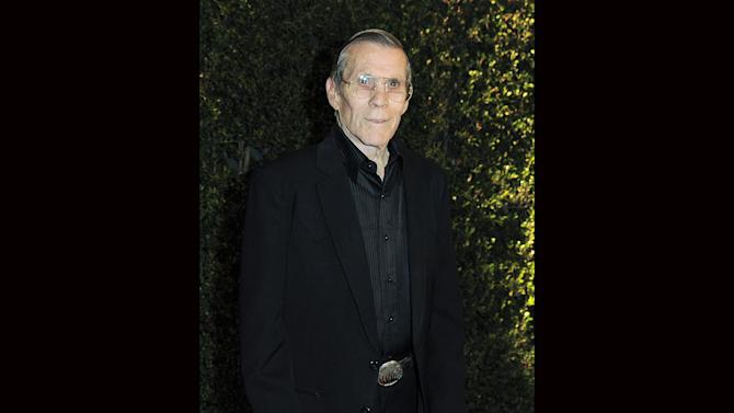 """FILE - In this Dec. 1, 2012 file photo, Hal Needham arrives at the 4th Annual Governors Awards at Hollywood and Highland Center's Ray Dolby Ballroom in Los Angeles. Needham, a top Hollywood stuntman who turned to directing rousing action films including """"Smokey and the Bandit"""" and """"The Cannonball Run,"""" died Friday, Oct. 25, 2013, his business managers told the Los Angeles Times. He was 82. (Photo by Jordan Strauss/Invision/AP, File)"""