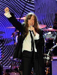 Recording artist Patti Smith performs at the Clive Davis Pre-GRAMMY Gala on Saturday, Feb. 9, 2013 in Beverly Hills, Calif. (Photo by Chris Pizzello/Invision/AP)