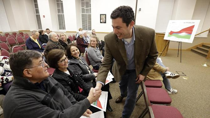 In this Feb. 7, 2013 photo, Rep. Jason Chaffetz, R-Utah, shakes hands with Richard Hart before a town hall meeting in Heber City, Utah. Chaffetz flew home from Washington last week to attend the town hall meeting. Many voters here and in similar communities elsewhere still want to do whatever it takes to stop President Obama, and the politicians they elect are listening. (AP Photo/Rick Bowmer)