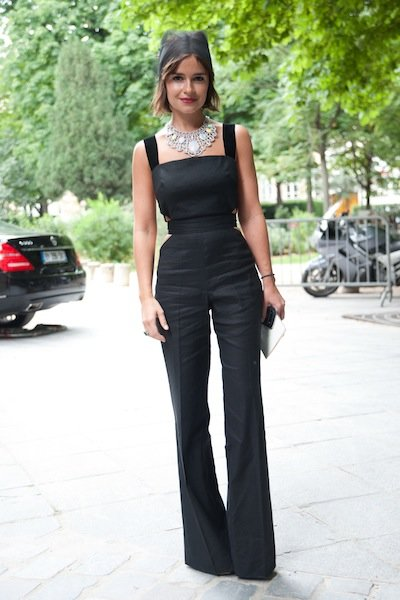 How about making a major statement in an evening jumpsuit? Make like Russian fashion writer Miroslava Duma in an impeccably tailored one with a flashy plate necklace and simple hairstyle. (Kristin Sin