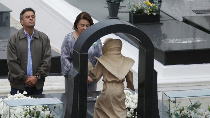 Brazil's presidential candidate Neves visits the grave of his grandfather, former president Tancredo Neves, in Sao Joao Del Rei