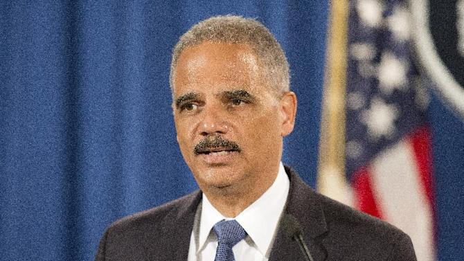 """FILE - In this Sept. 4, 2014, file photo, Attorney General Eric Holder speaks during a news conference at the Justice Department in Washington to announce the Justice Department's civil rights division will launch a broad civil rights investigation in the Ferguson, Mo., Police Department. City officials in Ferguson, Missouri, are pledging their full cooperation with a federal civil-rights investigation into their police department following the death of 18-year-old Michael Brown. Six months after 18-year-old Michael Brown died in the street in Ferguson, Missouri, the Justice Department is close to announcing its findings in the racially charged police shooting that launched """"hands up, don't shoot"""" protests across the nation.    (AP Photo/Pablo Martinez Monsivais, File)"""