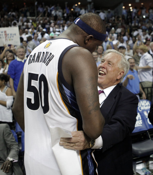 FILE - In this April 23, 2011 file photol, Memphis Grizzlies owner Michael Heisley, right, congratulates forward Zach Randolph (50) after the Grizzlies defeated the San Antonio Spurs in Game 3 of a fi