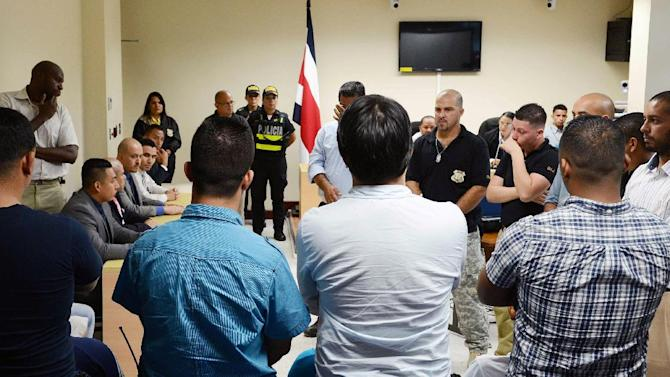 The seven men (mid row) accused of the murder of Jairo Mora Madrigal, listen to the verdict of not guilty, on January 26, 2015 in Limon, Costa Rica