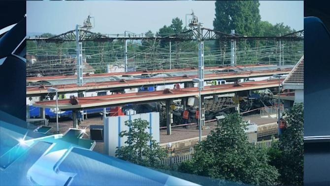 Breaking News Headlines: Crane to Clear Train Tracks in Deadly French Crash