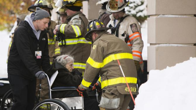 Firefighters from Cheektowaga and Depew attend to patients from from Garden Gate Health Care Facility in the town of Cheektowaga near Buffalo, New York