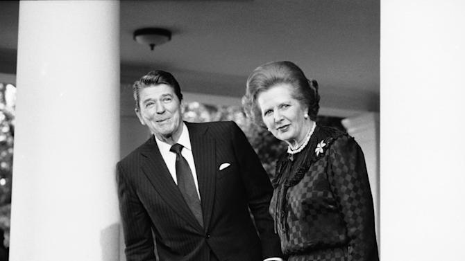 """FILE - In this June 23, 1982 file photo, President Ronald Reagan and British Prime Minister Margaret Thatcher speak to reporters at the White House in Washington.  Ex-spokesman Tim Bell says that Thatcher has died. She was 87. Bell said the woman known to friends and foes as """"the Iron Lady"""" passed away Monday morning, April 8, 2013. (AP Photo/File)"""