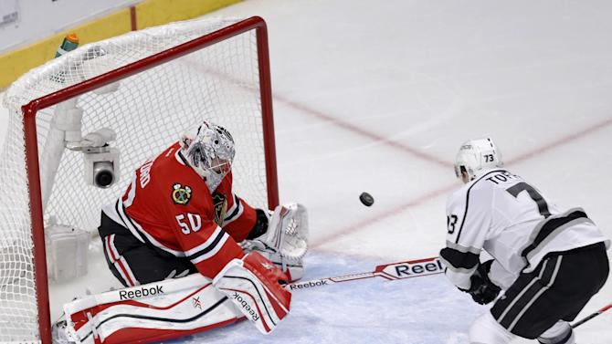 Los Angeles Kings center Tyler Toffoli, right, scores past Chicago Blackhawks goalie Corey Crawford during the second period of Game 1 of the Western Conference finals in the NHL hockey Stanley Cup playoffs in Chicago on Sunday, May 18, 2014