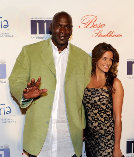 In this photo provided by the Las Vegas News Bureau, basketball great Michael Jordan and his girlfriend Yvette Prieto arrive for a celebrity dinner at Beso inside Crystals in City Center Thursday, Mar