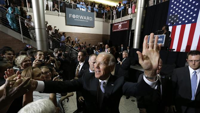 Vice President Joe Biden greets supporters during a campaign stop at Renaissance High School, Wednesday, Aug. 22, 2012, in Detroit. (AP Photo/Paul Sancya)