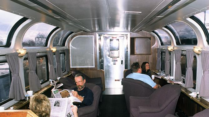 This undated photo provided by Amtrak shows passengers relaxing in a lounge car aboard the California Zephyr, which runs between Emeryville, Calif., and Reno, Nev. The 236-mile journey offers beautiful views as well as history. It crosses the Sierra Nevada mountain range and follows the same course as the historic Transcontinental Railroad, a 19th century engineering feat that bolstered the nation's western expansion. The Zephyr's ultimate destination is Chicago, a 51-hour trip from Emeryville. (AP Photo/Amtrak)