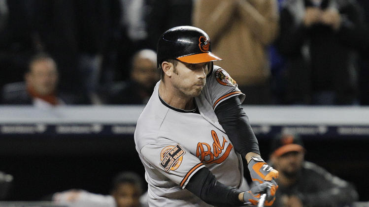 Baltimore Orioles' J.J. Hardy hits an RBI double during the 13th inning of Game 4 of the American League division baseball series against the New York Yankees on Thursday, Oct. 11, 2012, in New York. The Orioles won 2-1. (AP Photo/Kathy Willens)