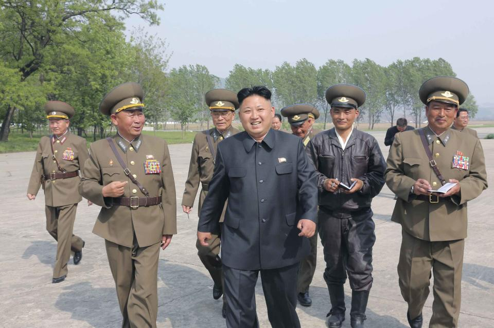 KCNA picture shows North Korean leader Kim Jong Un walking with officials during his inspection of Korean People's Army Air and Anti-Air Force...
