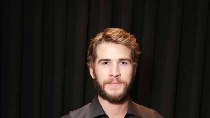 """Liam Hemsworth, cast member in the upcoming film """"The Hunger Games: Catching Fire"""" at Lionsgate Presentation at 2013 CinemaCon, on Thursday, April, 18th, 2013 in Las Vegas. (Photo by Eric Charbonneau/Invision for Lionsgate/AP Images)"""