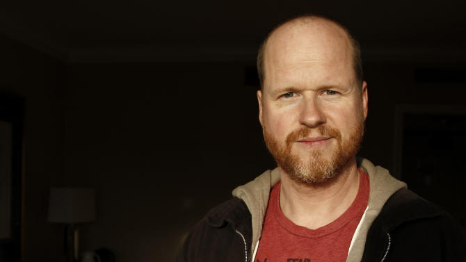 """FILE - This May 4, 2012 file photo shows writer and director, Joss Whedon, from the film """"The Avengers,"""" posing for a portrait in Beverly Hills, Calif. Whedon said Sunday, July 21, 2013 at Comic-Con International that the storylines of Buffy and his other Vampire Slayer title Angel & Faith will intertwine in interesting ways when Season 10 begins its published run. (AP Photo/Matt Sayles, File)"""