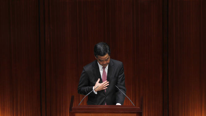 Hong Kong Chief Executive Leung Chun-ying  delivers his policy address at the Legislative Council in Hong Kong Wednesday, Jan. 16, 2013. Leung  focused on the social problems such as housing, pollution and economic development for the next five years. (AP Photo/Kin Cheung)