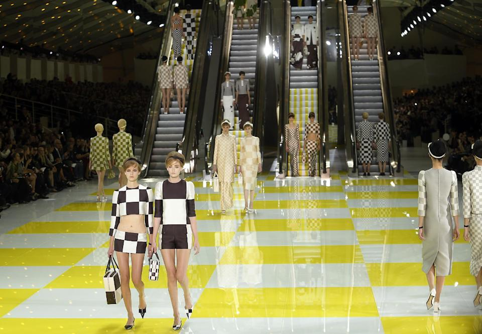 Models wear creations by fashion designer Marc  Jacobs for Louis Vuitton's ready to wear Spring-Summer 2013 collection presented in Paris, Wednesday, Oct. 3, 2012.  (AP Photo/Jacques Brinon)