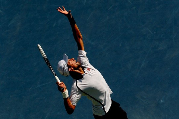 Novak Djokovic of Serbia returns a shot against Rogerio Dutra Silva of Brazil during their men's singles second round match on Day Five of the 2012 US Open at USTA Billie Jean King National Tennis Cen