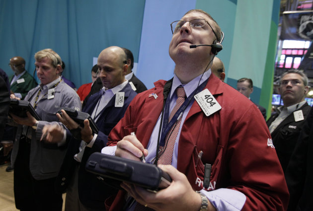Trader Ryan Falvey, foreground right, works on the floor of the New York Stock Exchange Friday, Aug. 3, 2012. U.S. stocks are rising sharply on Wall Street after a July jobs report revealed the strong