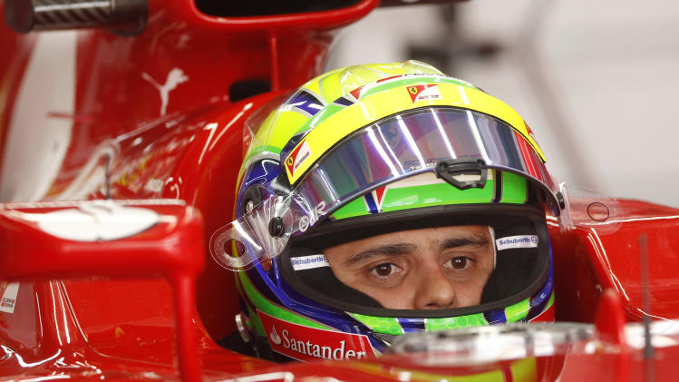 Ferrari driver Felipe Massa of Brazil waits inside his car during the second practice session for the Korean Formula One Grand Prix at the Korean International Circuit in Yeongam, South Korea, Friday, Oct. 12, 2012. (AP Photo/Dita Alangkara)