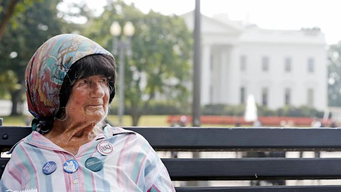 Protester Concepcion Picciotto, who holds a constant peace vigil in Lafayette Park across from the White House in Washington, sits on a park bench after her protest shelter was removed by Park Police, Thursday, Sept. 12, 2013. Picciotto, who held a peace vigil outside the White House since 1981, is up and running again after being dismantled for the first time in more than 30 years. (AP Photo/Charles Dharapak)