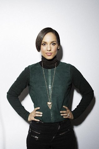 FILE - This Jan. 18, 2013 file photo shows actress and singer Alicia Keys posing for a portrait during the Sundance Film Festival in Park City, Utah. Fresh off her national anthem performance at the Super Bowl, Keys set to be the halftime entertainment for the NBA All-Star game on Feb. 17 in Houston. (Photo by Victoria Will/Invision/AP, file)