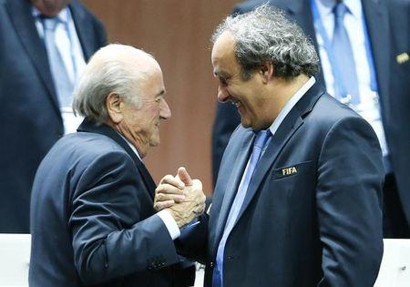 World soccer rocked by suspension of Blatter and Platini