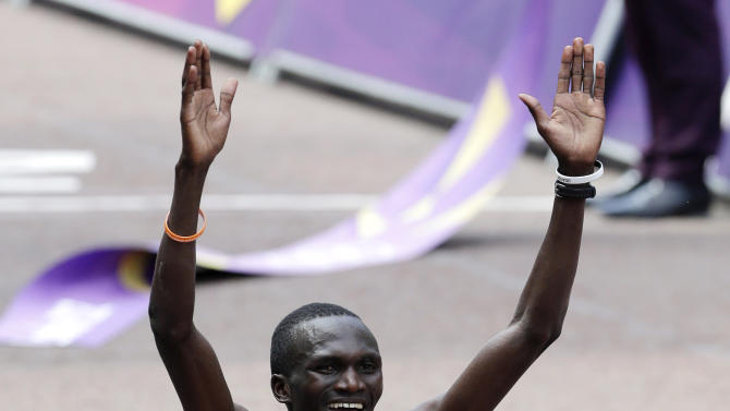 Gold-medalist Stephen Kiprotich of Uganda celebrates after the men's marathon at the 2012 Summer Olympics, Sunday, Aug. 12, 2012, in London. (AP Photo/Mike Groll)