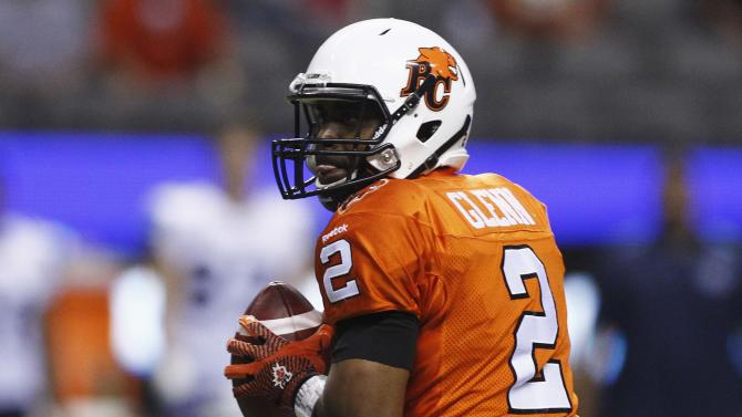 BC Lions' Kevin Glenn looks for a pass against the Toronto Argonauts during the first half of their CFL football game in Vancouver