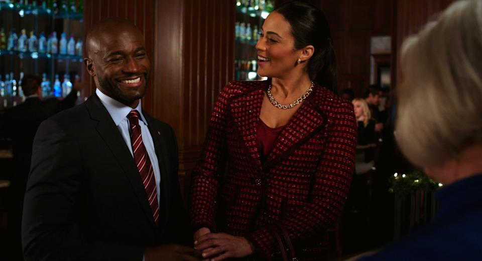 "This film image released by Fox Searchlight shows Taye Diggs, left, and Paula Patton in a scene from ""Baggage Claim."" (AP Photo/Fox Searchlight)"